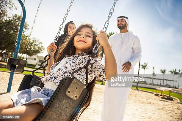 happy young traditional family in dubai, uae - images stock pictures, royalty-free photos & images