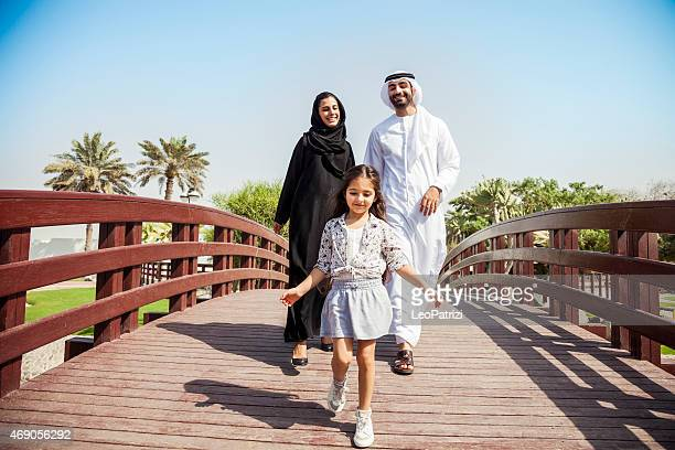 happy young traditional family in dubai, uae - united arab emirates stock pictures, royalty-free photos & images