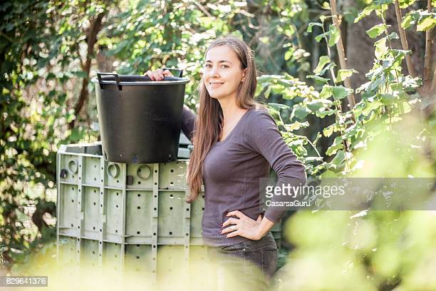 Happy Young Woman and her Compost Bin