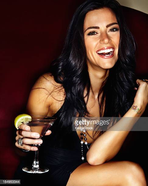 Happy young woman at a night club