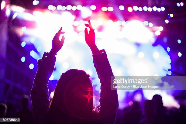 Happy young woman at music festival