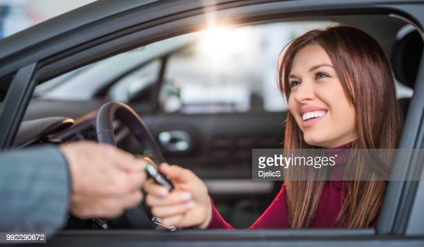 happy young woman buying her dream car. - car insurance stock pictures, royalty-free photos & images