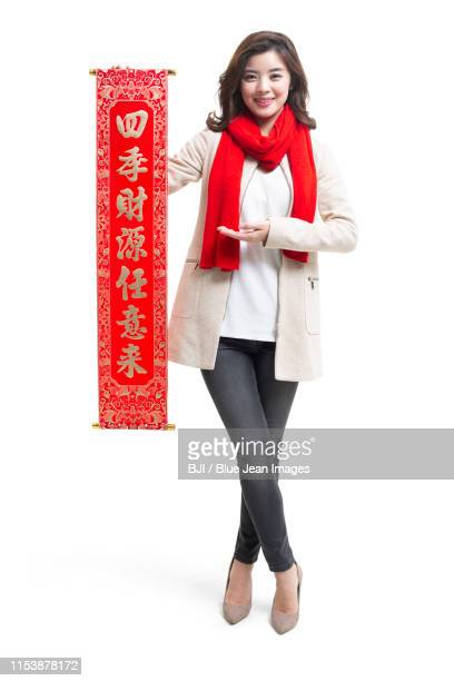 happy young woman celebrating chinese new year - neckwear stock pictures, royalty-free photos & images