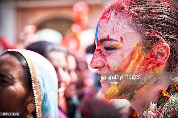 Happy young woman celebrating Holi in India.