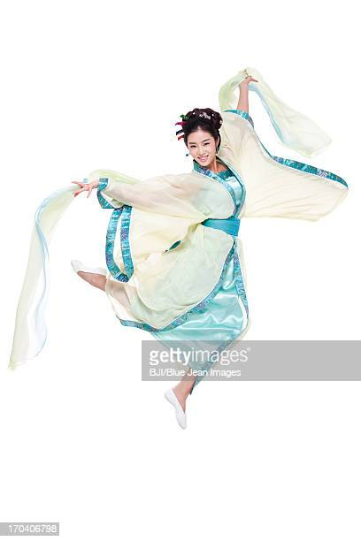 Happy young woman dancing in traditional Chinese costume