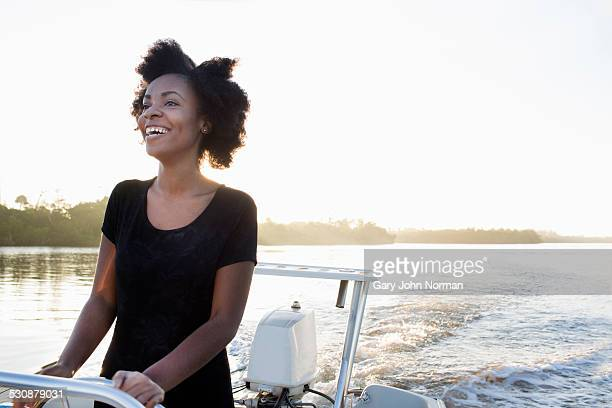 happy young woman driving motor boat. - juno beach florida stock pictures, royalty-free photos & images