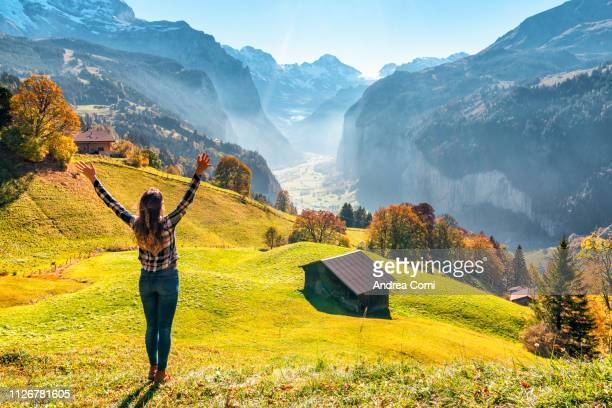 happy young woman enjoys the view from wengen - ベルンカントン ストックフォトと画像