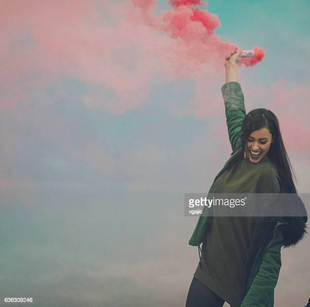 Happy Young Woman Having Fun Outdoors With Smoke Fountain.