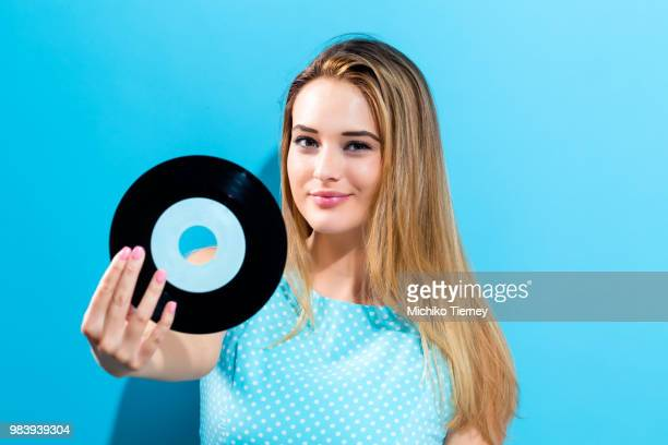 Happy young woman holding a record
