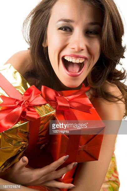 happy young woman holding gift boxes