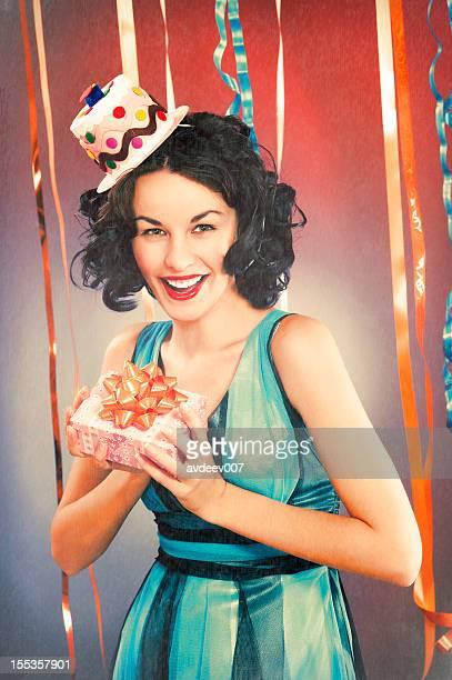 happy young woman holding the present - happy birthday vintage stockfoto's en -beelden