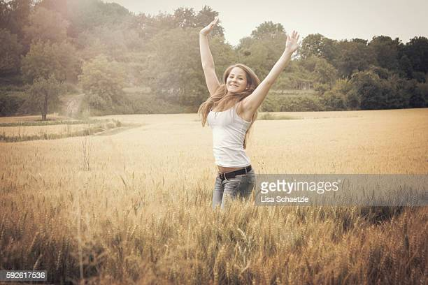 Happy young woman in a cornfield