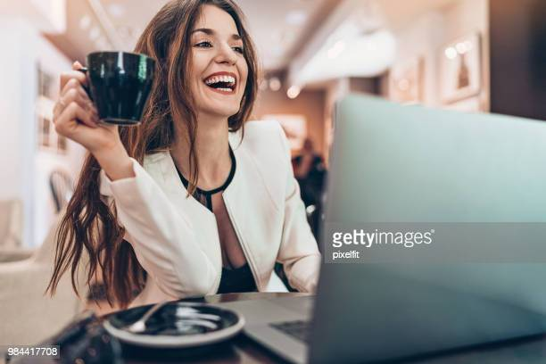 happy young woman in cafe - beautiful woman chest stock pictures, royalty-free photos & images