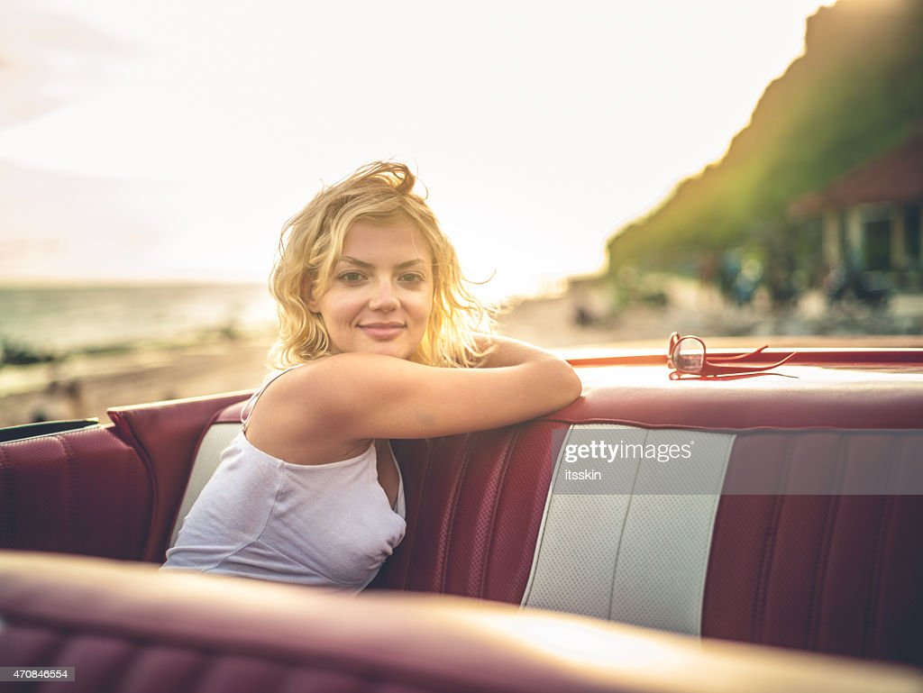 82b5c48fe Happy Young Woman In Convertible Car Stock Photo | Getty Images