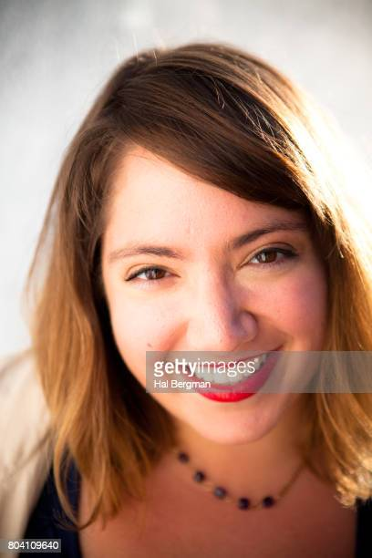 Happy Young Woman in Sunlight