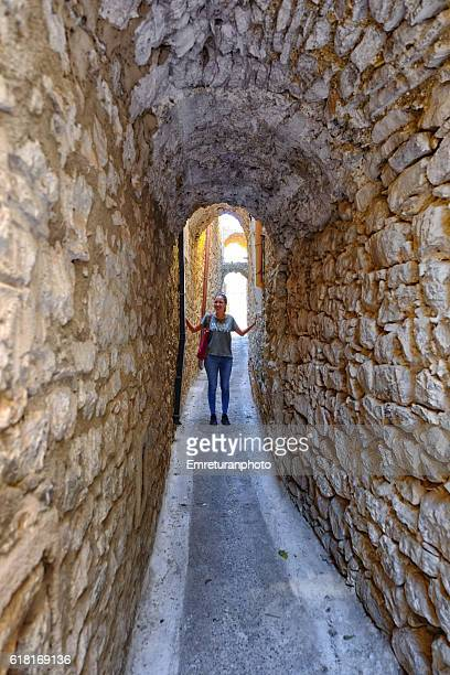 happy young woman in the narrow streets of pyrgi - emreturanphoto stock pictures, royalty-free photos & images