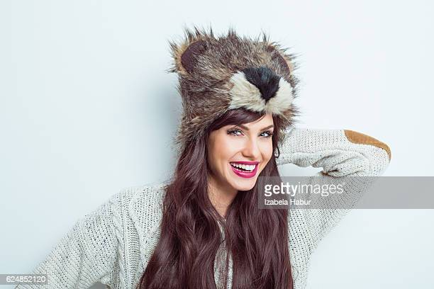 happy young woman in winter clothes - fur hat stock photos and pictures