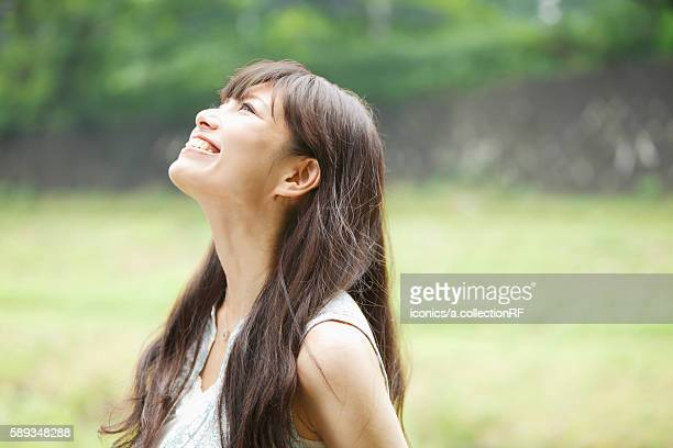 Happy Young Woman Looking Up
