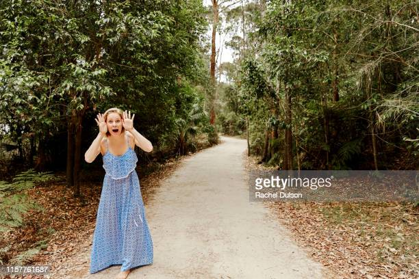 happy young woman on a path in the woods - long dress stock pictures, royalty-free photos & images