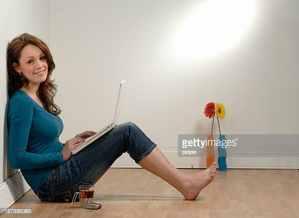 happy young woman on laptop - skinny jeans stock pictures, royalty-free photos & images