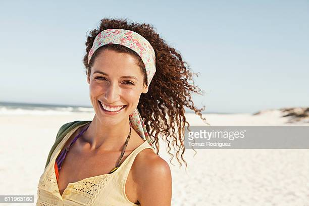 Happy young woman on sandy beach