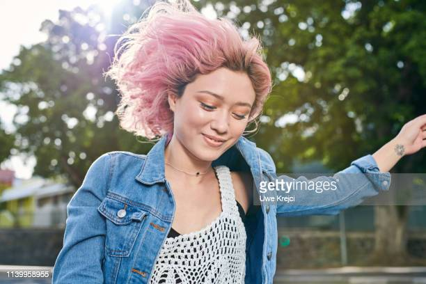 happy young woman - pink hair stock pictures, royalty-free photos & images