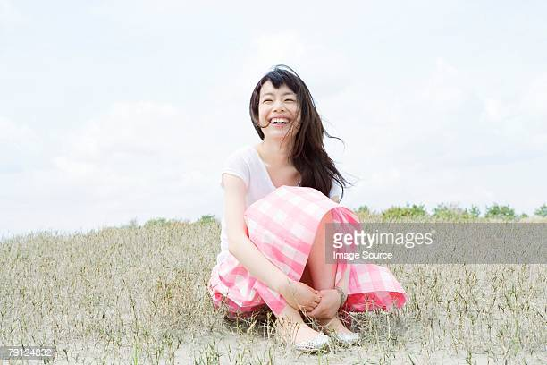 happy young woman - wind blows up skirt stock pictures, royalty-free photos & images