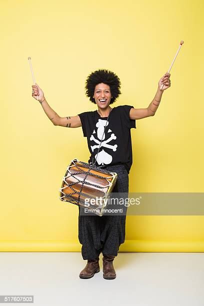 happy young woman playing african drum - drum container stock pictures, royalty-free photos & images