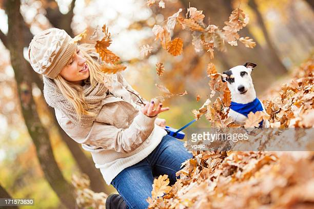 Happy Young Woman Playing With her dog outdoors.