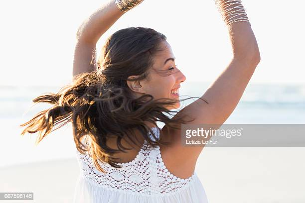 Happy young woman posing on the beach