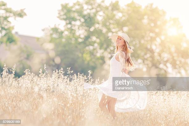 happy young woman spinning with open arms