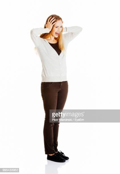 Happy Young Woman Standing Against White Background