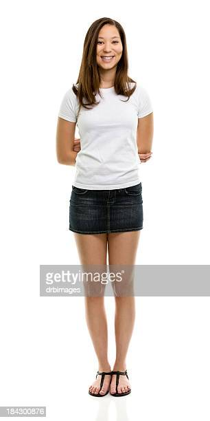 happy young woman standing portrait - white skirt stock photos and pictures