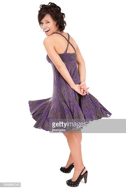 Happy Young Woman Twirling in Purple Dress