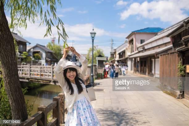 Happy young woman visiting Ono River, Sawara, Chiba, Japan