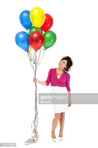 happy young woman with balloons - green skirt stock pictures, royalty-free photos & images