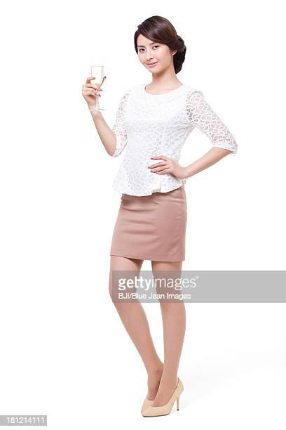 Happy young woman with champagne