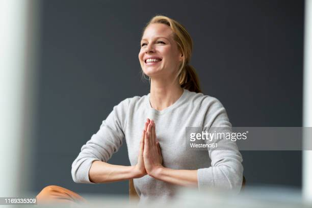 happy young woman with clasped hands - escapism stock pictures, royalty-free photos & images