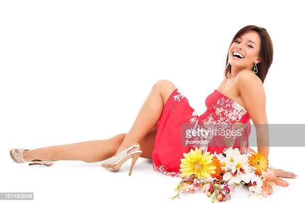 happy young woman with flowers - middellang haar stockfoto's en -beelden