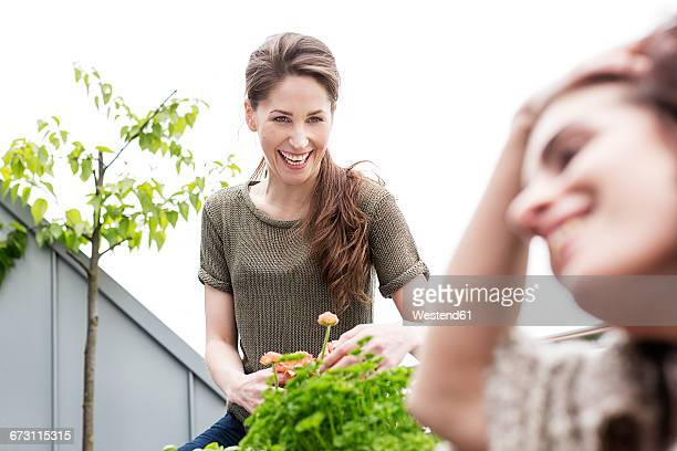 Happy young woman with friend on balcony