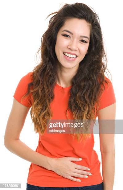 Happy Young Woman With Hand On Stomach