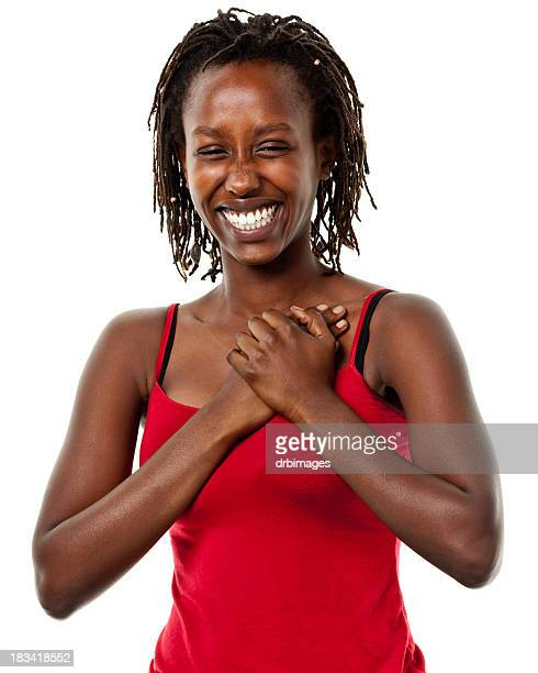 Happy Young Woman With Hands On Chest
