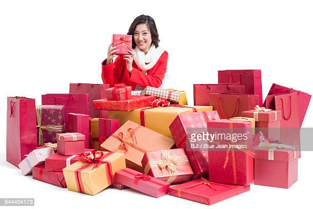 Happy young woman with many gifts
