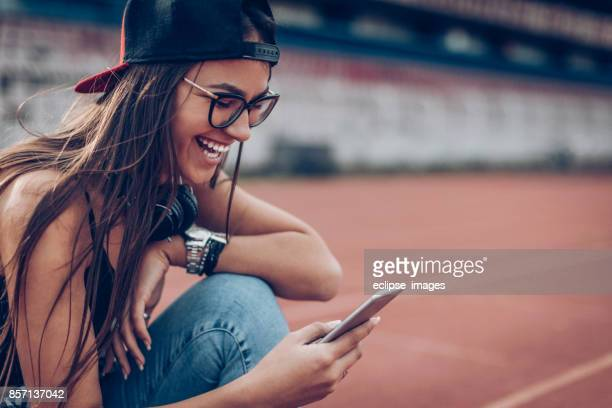happy young woman with smart phone - text stock pictures, royalty-free photos & images
