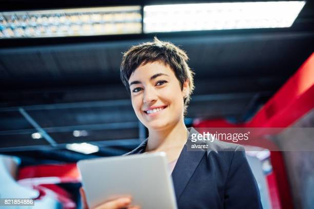 Happy young woman working at startup