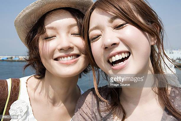 Happy young women by the coast