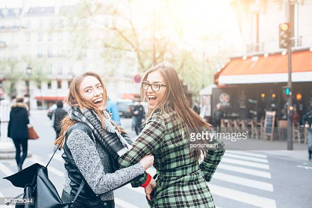 Happy young women having fun on street