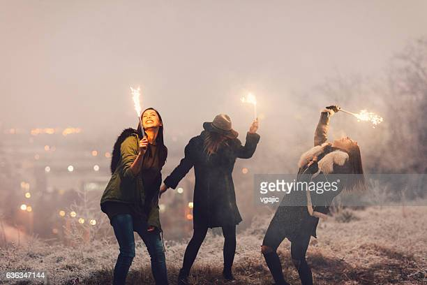 Happy Young Women Having Fun Outdoors With Firewors.
