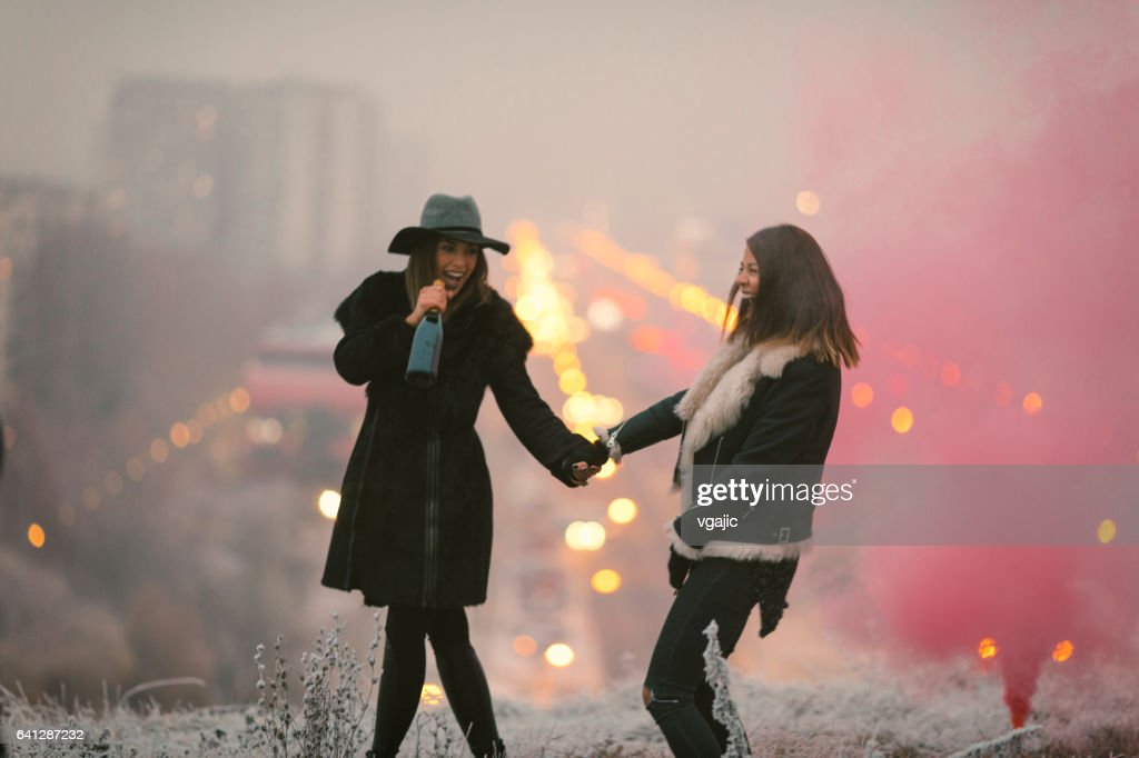 Happy Young Women Having Fun With Smoke Bomb High-Res