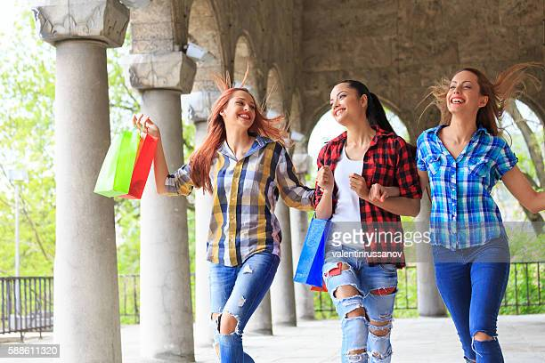 Happy young women holding their new purchases
